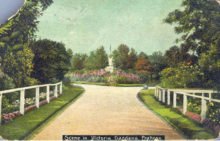 This c1905 view taken from the Murray Street entrance shows the statue of Victory that was erected in the Gardens in 1888. The statue is reported to be an exact copy of the famous statue erected in La Place et le poat de Belle Alliance, Berlin to commemorate the Battle of Waterloo.  The original statue, which had been damaged is now in a courtyard at the Prahran Town Hall and has been replaced by a bronze copy.  At the end of the path is a stone drinking fountain.  The straight path was altered in about 1906 when the fountain was relocated.